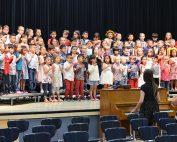 Hammond students performing on bleachers