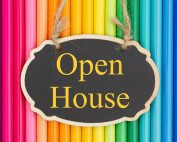 Open House sign over colorful pencils