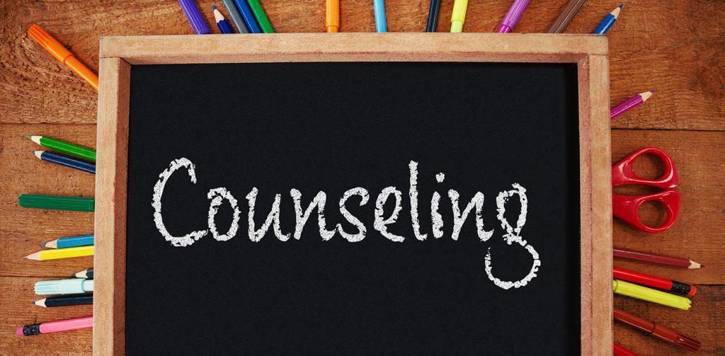 Word Counselling in chalk on blackboard